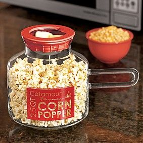 Microwave Popcorn maker made of Glass.  The lid has a mesh basket for butter which will melt directly onto your popcorn while it is popping!  How clever!