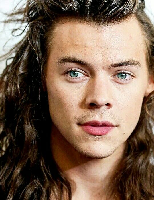 Harry Styles 2015    do you see this beautiful angel with the pink plump lips and bright green eyes and gorgeously curly long mermaid hair? yeah, him. hes going to be the cause of my death. @starrybeauty