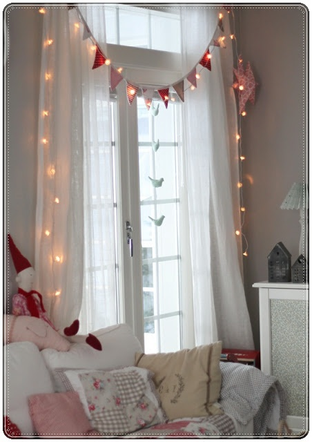 Fairy lights, bunting and voile drapes could be the perfect addition to your little girl's bedroom window