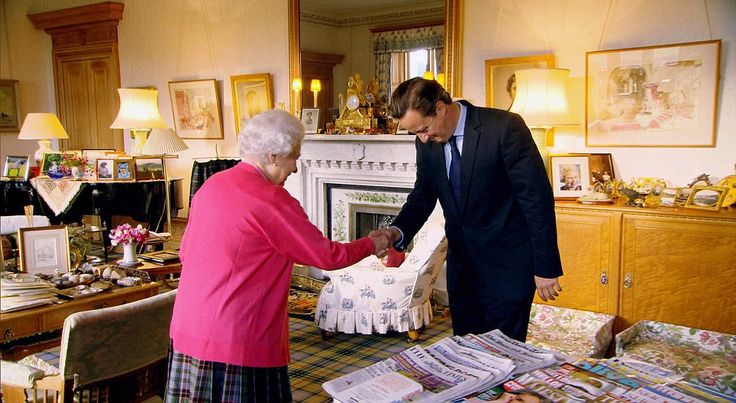 Cosy: The Queen at her audience with Prime Minister David Cameron in her Private sitting room in Balmoral. With all the cosiness of a grandmother's front room, the comfortable clutter includes mismatching chairs and lamps on tartan carpet, air freshener sticks, and magazines including Majesty and the Racing Post