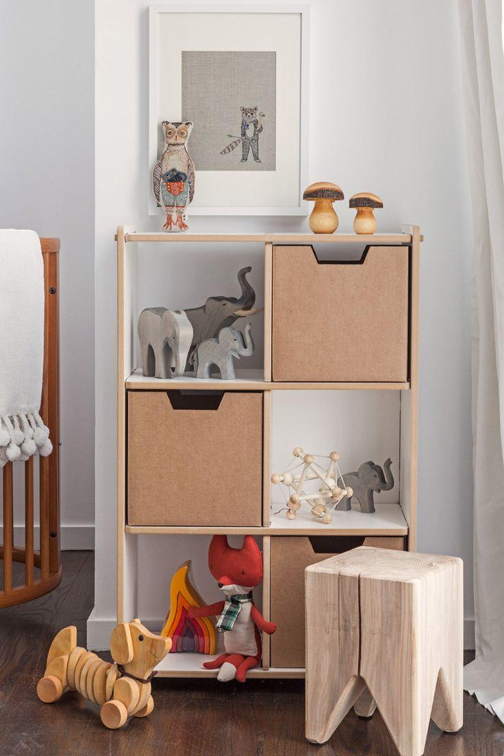 A gender neutral modern animal nursery featuring Animal Print Shop prints, Stokke crib, Eames rocker and fun accessories.