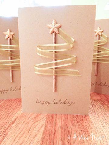 simple christmas tree card using lolly stick or straw as trunk, ribbon as branches and gold star topper