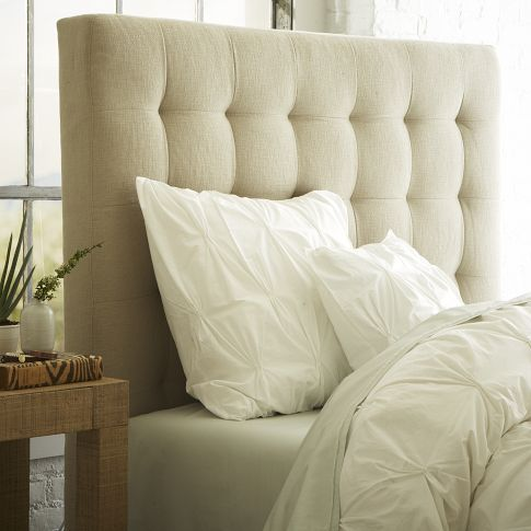 This tall, tufted headboard adds an element of drama.