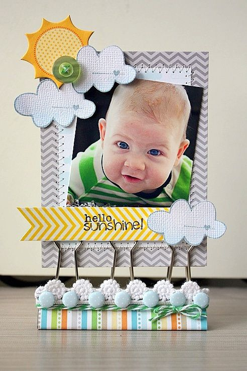 what an awesome idea for smaller photos....the perfect thing to pretty up your office desk!