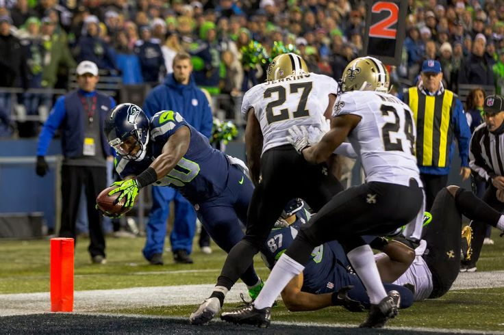 Off of an eight-yard pass from Russell Wilson, Seahawk Derrick Coleman, left, dives into the end zone to score a touchdown against the New Orleans Saints during the second half of game Monday, Dec. 2, 2013, at CenturyLink Field in Seattle. The Seahawks beat the Saints 34-7. (Jordan Stead, seattlepi.com)