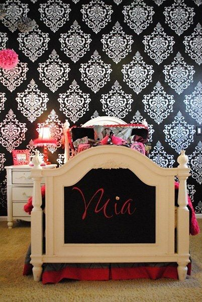 Black and white wall stenciling can be SO cool for a little girl's room! Bright pink accents dress up Ornamental Cartouche wall stencil by @Carmen Benoit of Carmen Illustrates.