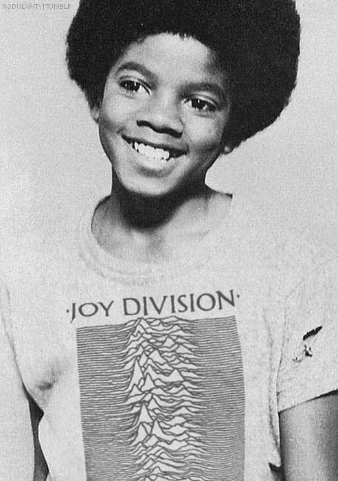 Young Michael Jackson wearing a Joy Division t-shirt.