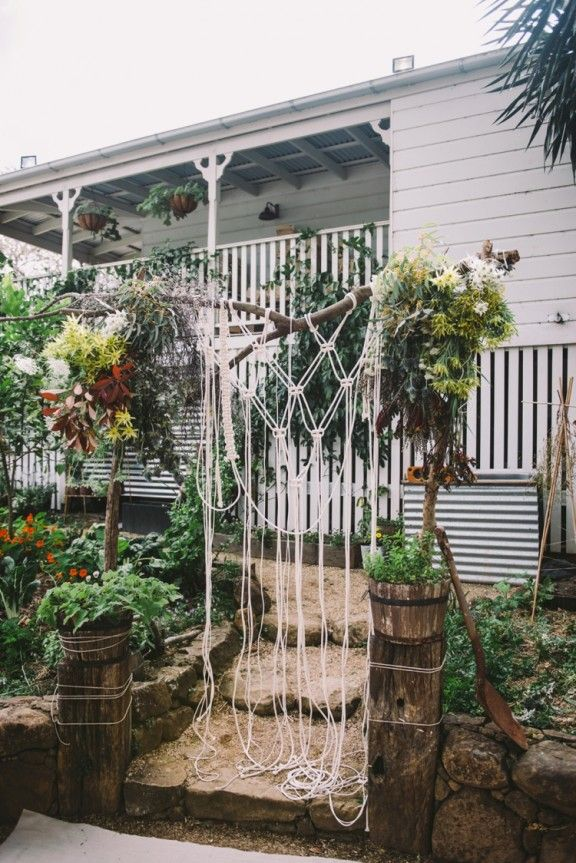 Macramé wedding aisle backdrop | Photography by Lara Hotz