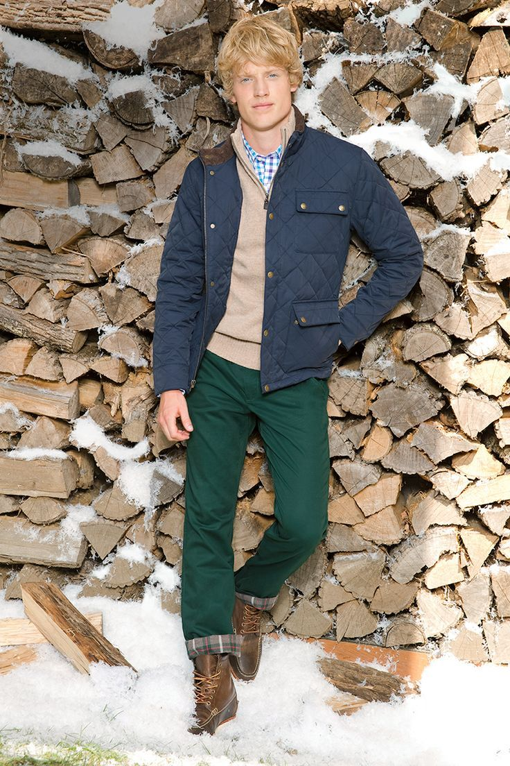 Wear a navy quilted jacket with dark green chinos for a trendy and easy going look. Smarten it up with brown leather boots.  Shop this look for $278:  http://lookastic.com/men/looks/longsleeve-shirt-zip-sweater-jacket-chinos-boots/4404  — Light Blue Plaid Longsleeve Shirt  — Beige Zip Sweater  — Navy Quilted Jacket  — Dark Green Chinos  — Brown Leather Boots