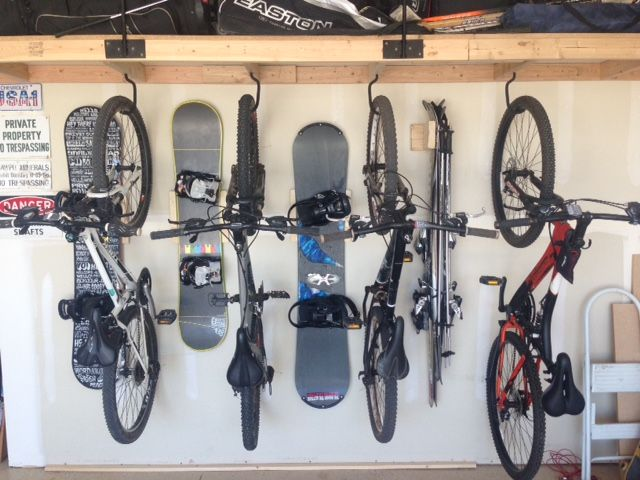 Space saving in garage. Garage storage for bicycles, Snowboards, ski's and a shelf above.