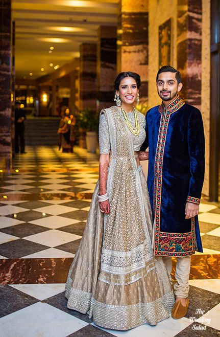 Real Indian Wedding - Manoshi and Atit | WedMeGood | Steel Grey and Beige Dull Gold Silk Lehenga with Sequinned Blouse and a Net Sequinned Hevy Dupatta, Groom in a Blue Velvet Sherwani and Churidar  #realwedding #indianwedding #wedmegod #indianbride #lehenga #sherwani #coupleshot #velvet #blue #gold
