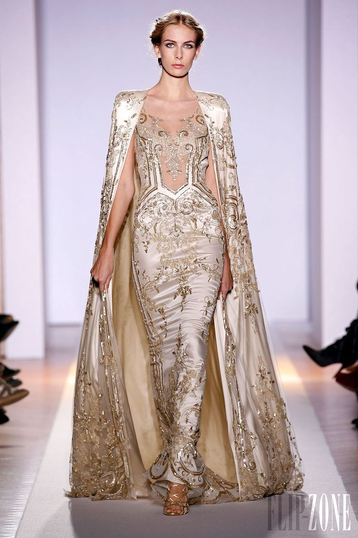 Zuhair Murad - Couture - Official pictures, S/S 2013 - http://en.flip-zone.com/fashion/couture-1/fashion-houses/zuhair-murad-3366 - Ample cape in pearl colored silk tulle on a sleeveless mermaid dress hand-embroidered with baroque motifs in aged gold.