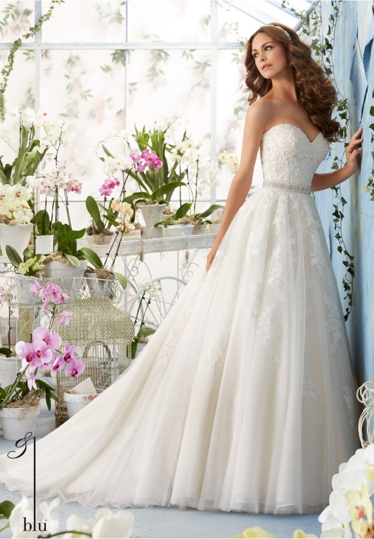 Wedding Gowns By Blu featuring Alencon Lace Appliques with Crystal Beading on the Tulle Ball Gown Removable Beaded Organza Tie Sash included, but also sold separately as Style 11229. Colors available: White, Ivory, Ivory/Light Gold.