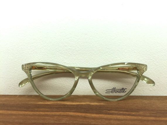 1980's Vintage Silhouette Iridescent Studded Cat Eye Glasses by blackandbluevintage on Etsy https://www.etsy.com/listing/220107973/1980s-vintage-silhouette-iridescent
