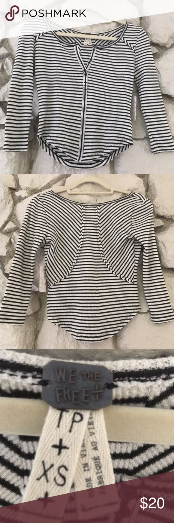 Free People 'Stars & Stripes' Thermal Tee A super cute and affordable fashion piece from Free People. This top has a split neck detail with partial front button closure. The 3/4 length sleeves make it easy to wear and the stripes give off a stylish vibe. The fit of this tee make it super easy to pair and wear! Brand new with tags! Originally purchased from Nordstrom Rack and sold out in all colors. Size: XS. Color: Ivory Combo. Free People Tops Tees - Long Sleeve