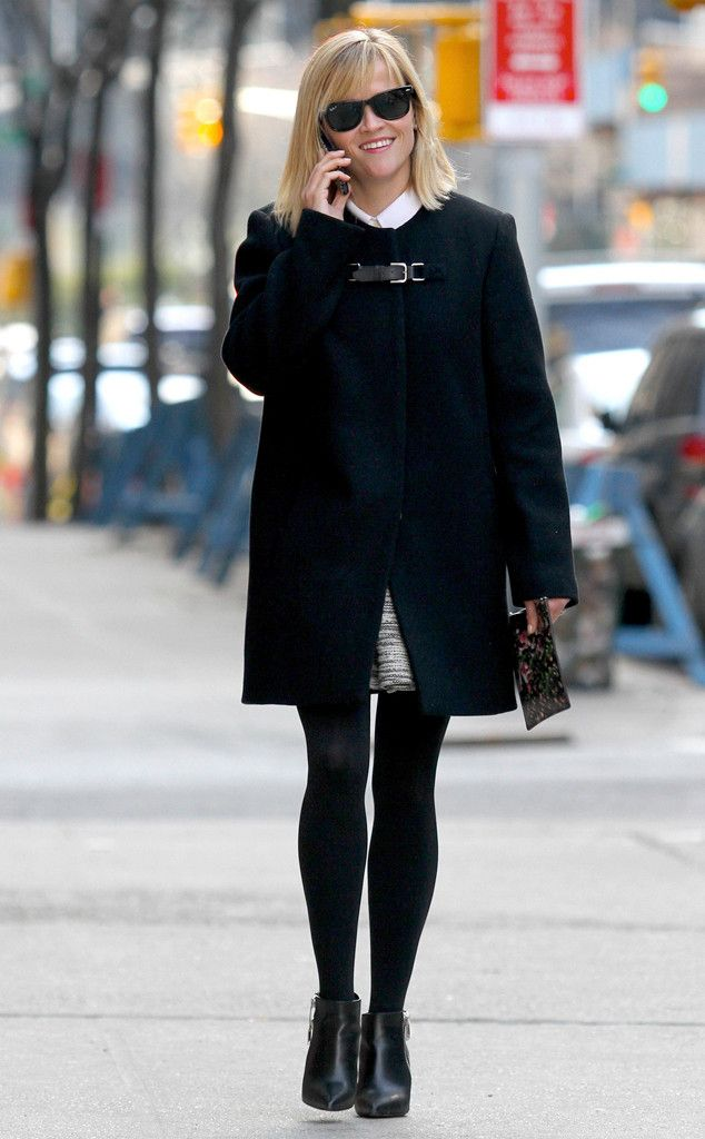 Reese's Pieces from Celebrity Street Style  The Oscar winner bundled up in dark coat and black tights whileout and about in Manhattan in New York City.