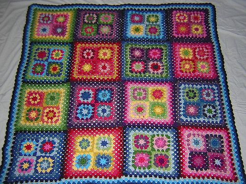 Big (Medium) Blanket - finished! by snippygal, via Flickr - i like how she used 4 granny squares into one bigger square to make the afghan