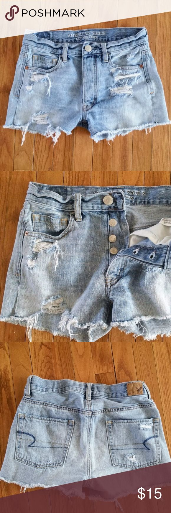 """American Eagle Cutoff Jean Shorts Distressed Denim American Eagle Jean Shorts Cut Off Button Fly Distressed Size 00     Women's Size: 00 ( See Measurements- Generous Fit )  Button Fly Cut Off Distressed Denim  Rise Measures Approx 9.5 """"  Inseam Measures Approx 2"""" Waist Measures Approx 14"""" Across Lying Flat  Smoke & Pet Free Home American Eagle Outfitters Shorts Jean Shorts"""