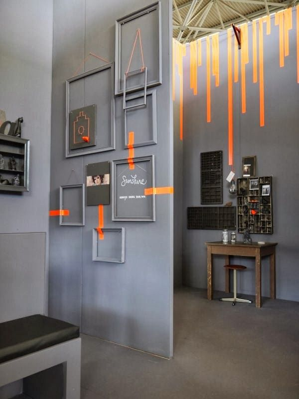 Orange color over grey. Nice styling. Woonbeurs 2013 favorites | Black   Grey   Orange #creative #styling #wall