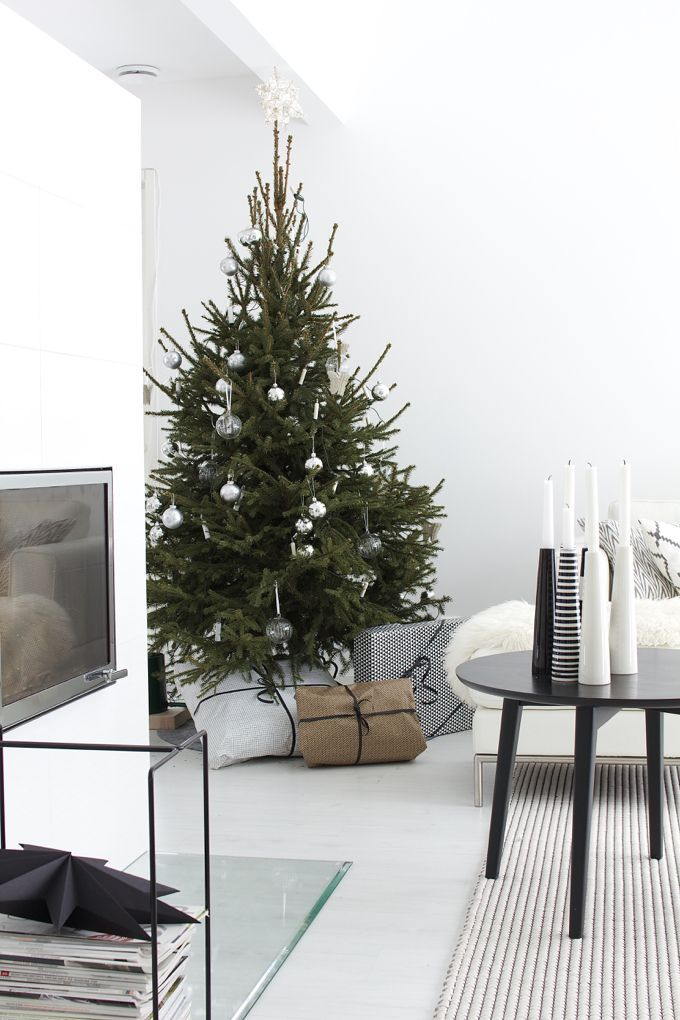 Christmas tree in living room, white shades, fireplace