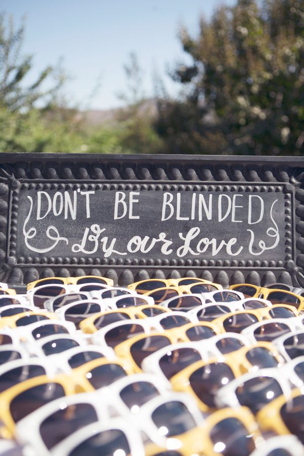 Hilarious wedding favors so guests can see during an outdoor ceremony, photo by Christine Bentley Photography | via junebugweddings.com