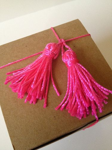 Neon Pink Twine Gift Adornment - tutorial by Fabric Paper Glue