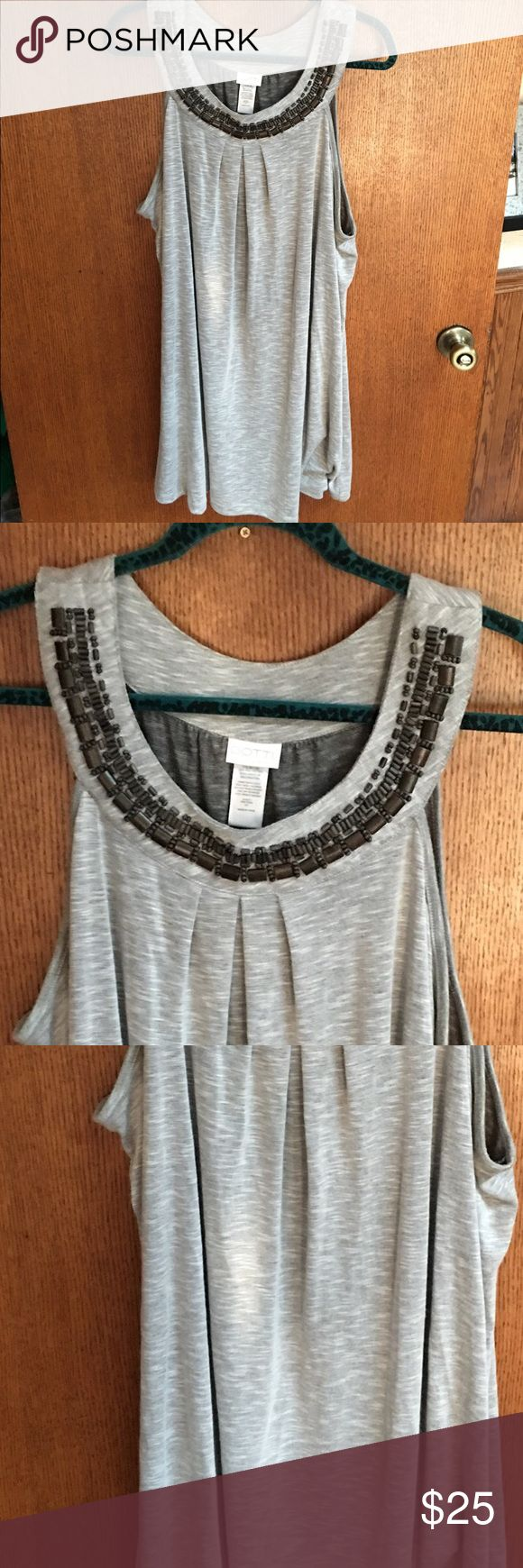 Women's 2X loose fit dress Women's 2X loose fit dress. Has beautiful beads all around the front collar. Like new/great condition. Worn maybe 2 times, 1 for sure. Great summer dress & super cute with Capri or under the knee leggings. Dotti Dresses Midi
