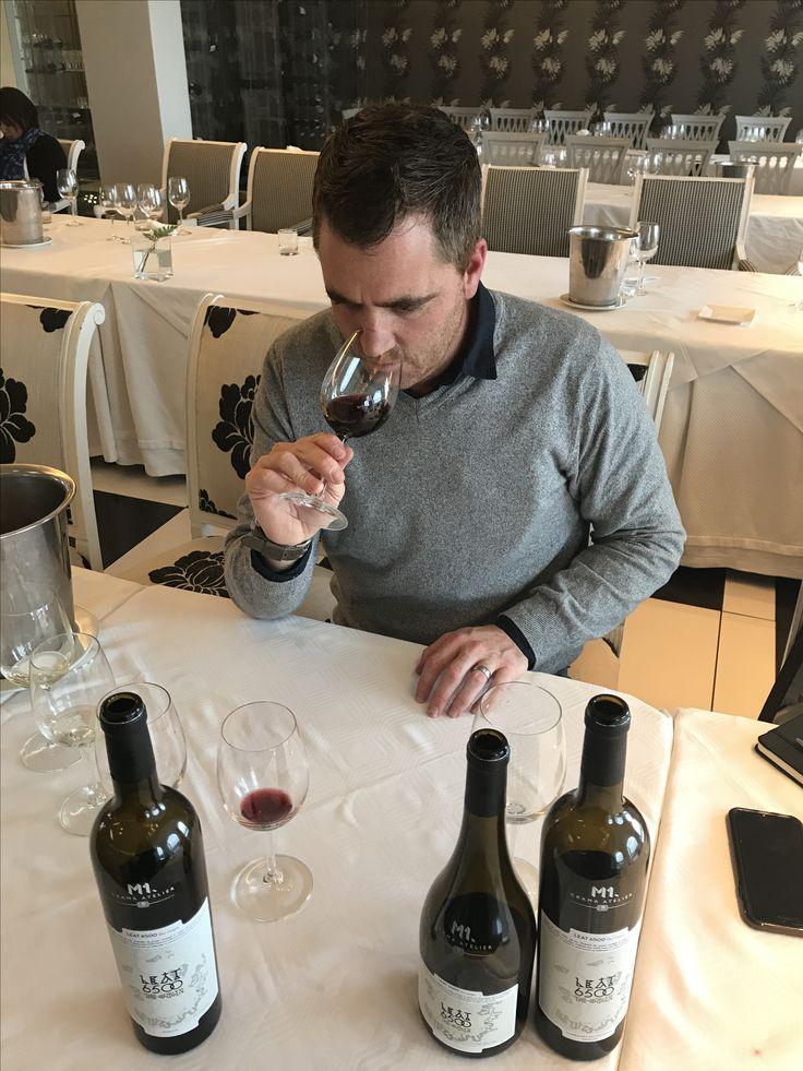 Wilhelm Pienaar of Hermanuspietersfontein tasting wine at Hermanus FynArts.