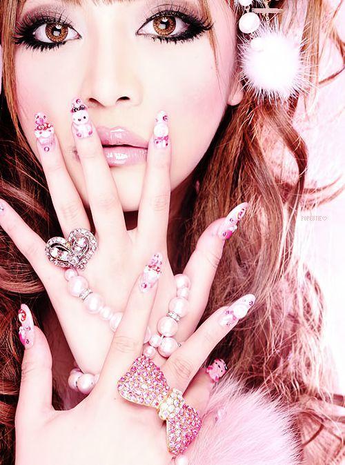 Kawaii perfected: confectioner's sugar sweet nails, doll-perfect makeup, like visually drinking a milkshake.