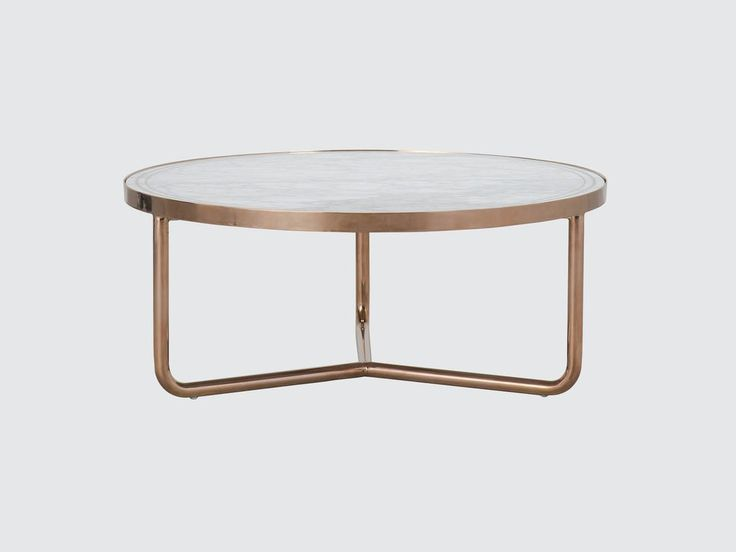 Art Deco brass inlay sets off Mediterranean cool in the Hollywood coffee table. Crafted from crisp white marble the circular...