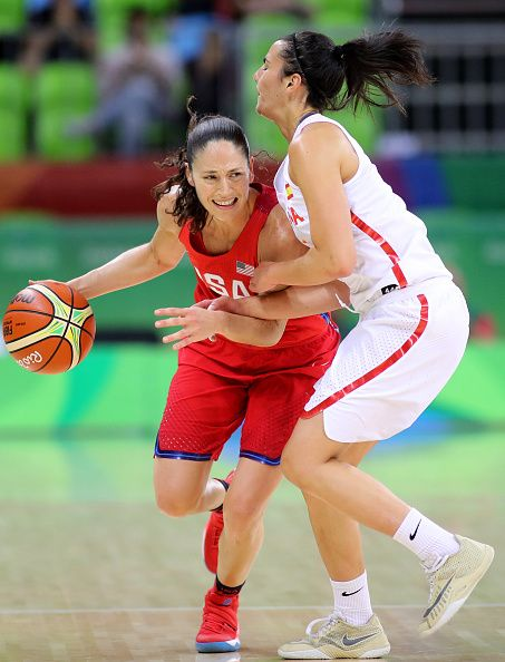 #RIO2016 Day 3 Sue Bird of United States is fouled by Leticia Romero of Spain during the USA Vs Spain Women's Basketball Tournament at Youth Arena on August 8...