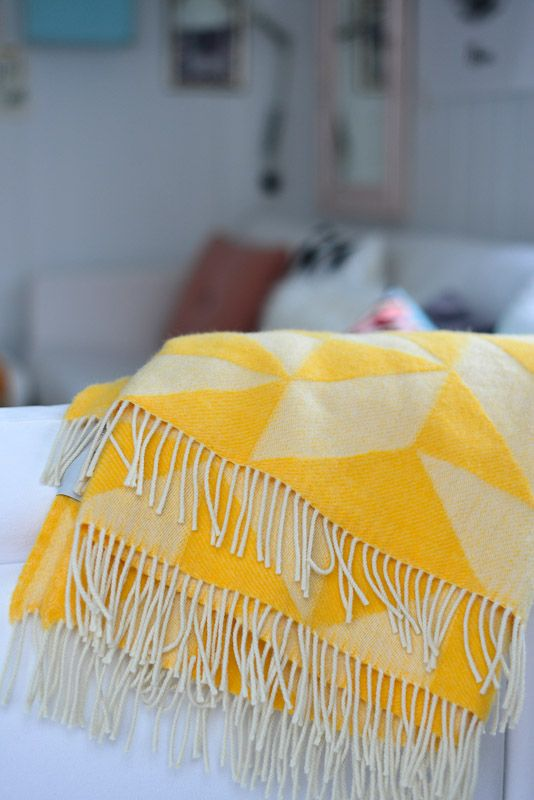 Yellow and white fringed throw with quilt pieces look. Adorable !!!! I would really like one of these please :)