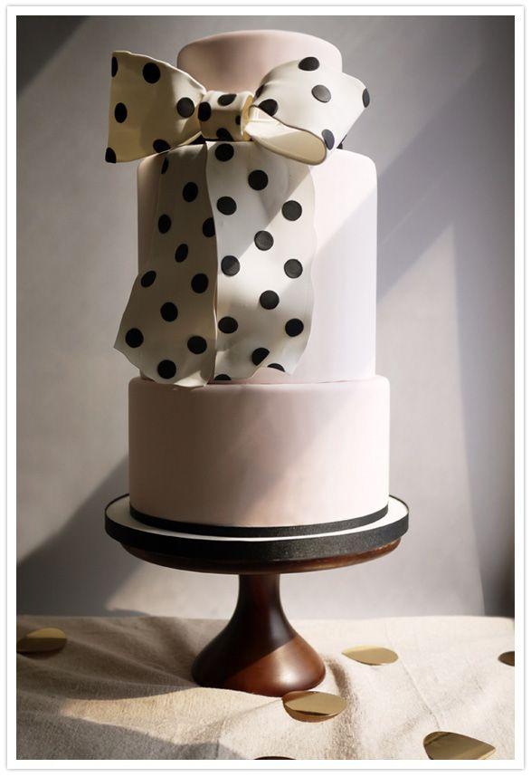 Light pink cake with polka dot bow.