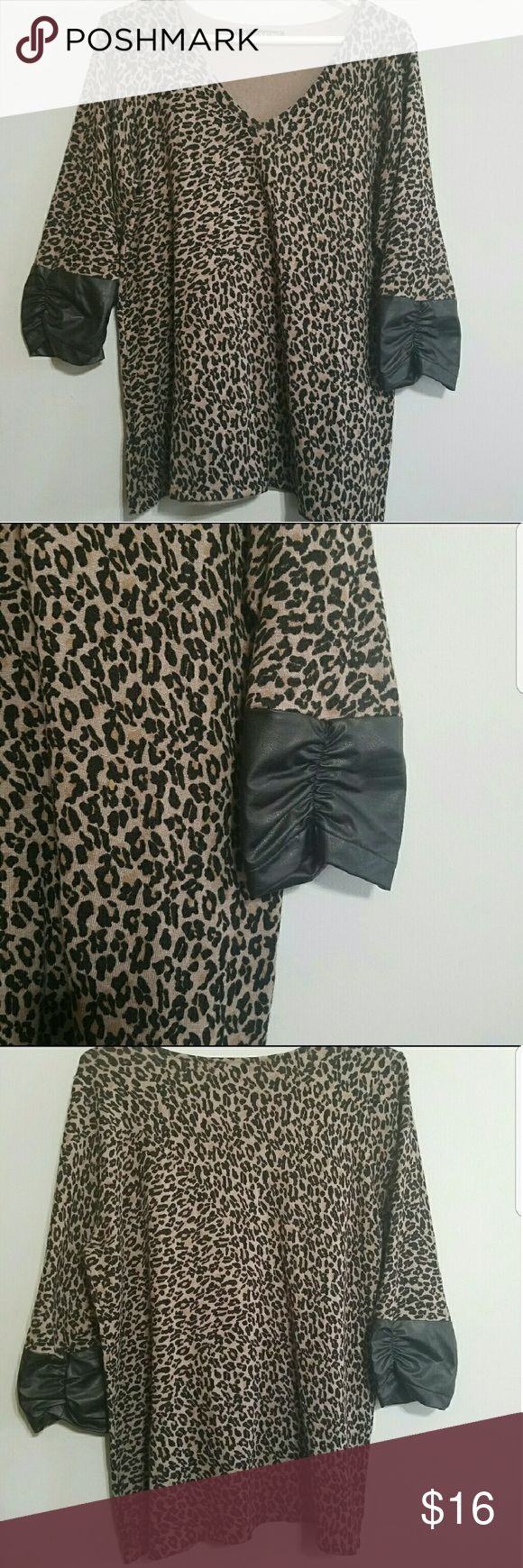 """Maurices Cheetah Print Shirt Faux Leather Size 1X Sassy! Caramel colored Leopard print. 3/4 sleeves. Faux black leather on the sleeves with ruching.  Maurices size 1 Some wash wear. Light pilling in underarm area. Gorgeous!  Approximate measurements flat- Bust-21"""" Length 28"""" Maurices Tops"""