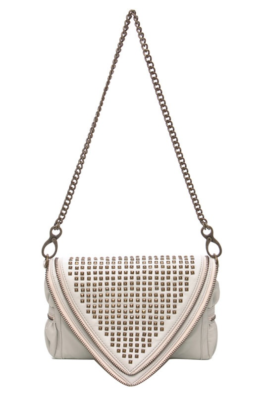 """Matt&Nat  Laroux Handbag In Bone  $160.00$62.99      Bone vegan leather handbag with 100% recycled aqua faux suede lining, tone on tone stitching and antique brass hardware      The Laroux features flap and snap with zip closure      The interior features zip, cell phone and PDA pockets        Color: Bone      Composition: 100% Polyurethane      Origin: China      Approximate Measurements: 10.5"""" x 8.5"""" x 1.5"""""""