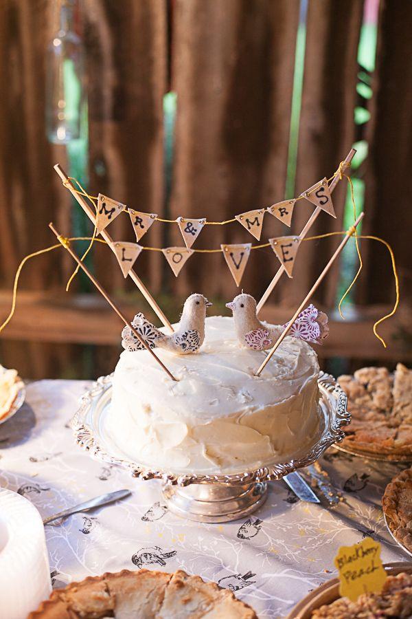 lovebird cake topper with bunting #lovebirds #buntingcaketopper #supercuteweddingcake http://www.weddingchicks.com/2013/11/01/diy-barn-wedding-2/