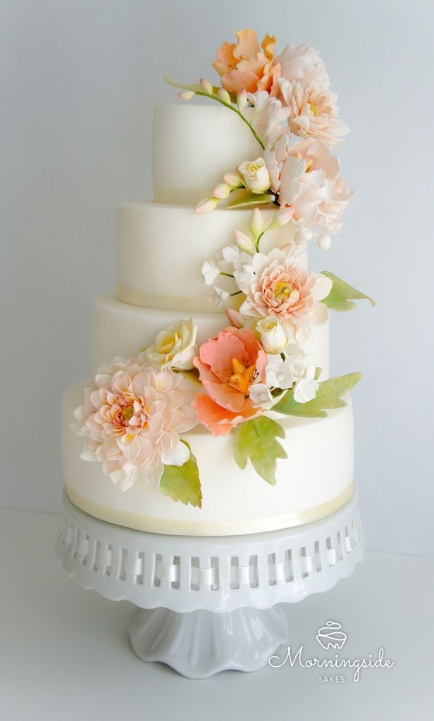 3 tier wedding cake with garden sugar flowers in coral shades. Sugar dahlia, peonies, roses and buds.
