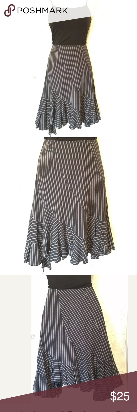 """Armani Exchange Striped Blk & White Ruffle Skirt Women's Armani Exchange Striped Black And White Ruffle Skirt  Size 6 Measurements: Waist: 30"""" Hips: 38-40"""" Length: 23.5"""" Condition: Excellent  This beautiful skirt is made from 100% cotton, and zips up on the side. The bottom of the skirt is designed slightly asymmetrical, with ruffles.  Thank you for considering this item! A/X Armani Exchange Skirts Asymmetrical"""