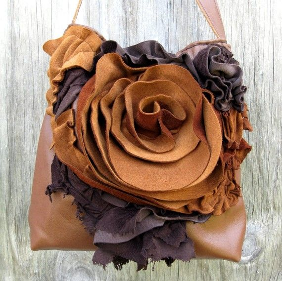 Brown Leather rosette messenger bag. I have to get my hands on some leather and try this.