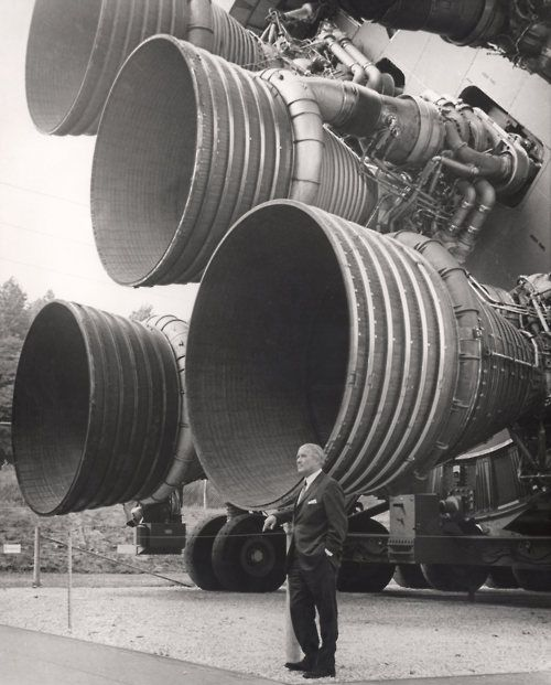 Werner von Braun standing in front of the Saturn V rocket in Rocket Park, U.S. Space & Rocket Center, Huntsville, AL