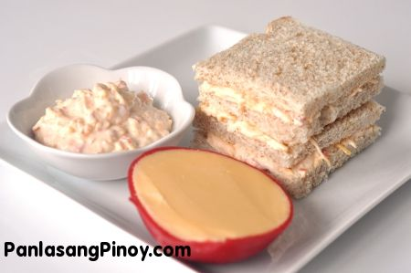 Cheese Pimiento Sandwich Spread is a type sandwich spread made from mayonnaise, grated or shredded cheese, and pimiento. This recipe calls for either Edam cheese or left over queso de bola, or shredded cheddar cheese.