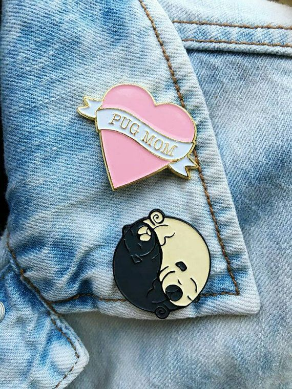 1.25 each soft enamel pins  Pug mom heart pin - gold military clutch with gold metal back  Yin yang pug - silver military clutch with black back. Wear them with pride on your jacket, bag,vest,lanyard,backpack or anywhere.  I was inspired to design these pins by my pugs. Hope you like them as much as I do :)  $1 of the purchase will be donated to a pug rescue - PUG NATION LA  adopt dont shop :)