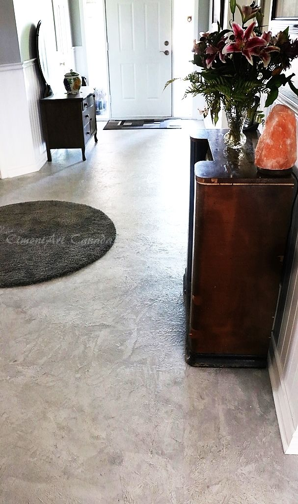 CimentArt Stone CimentArt products are available in either mat, satin or gloss finishes and in a wide range of colors to suit your décor. Nice Foyer!