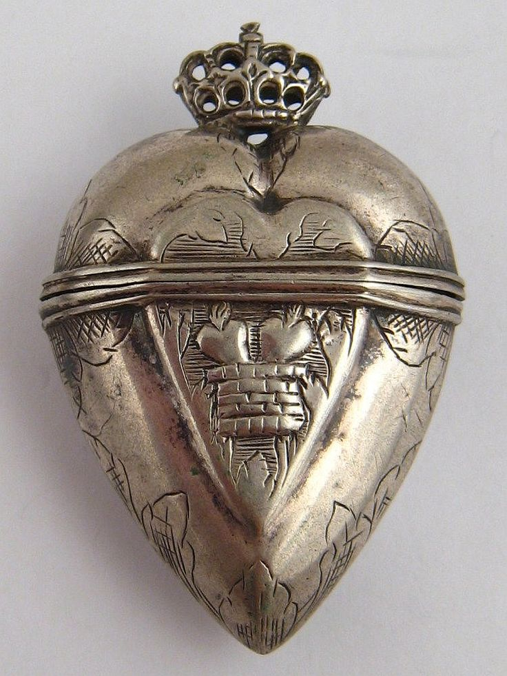 A Scandinavian white metal (test silver) ''marriage box'' designed as a crowned heart, approx. 8.5cm, 21.3 grams, circa 1800.