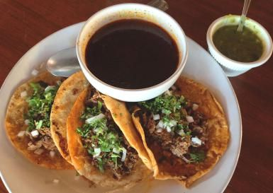 Make Your Own Birria with this Easy Family Recipe: Traditional Mexican tacos de birria with consomé and green sauce.