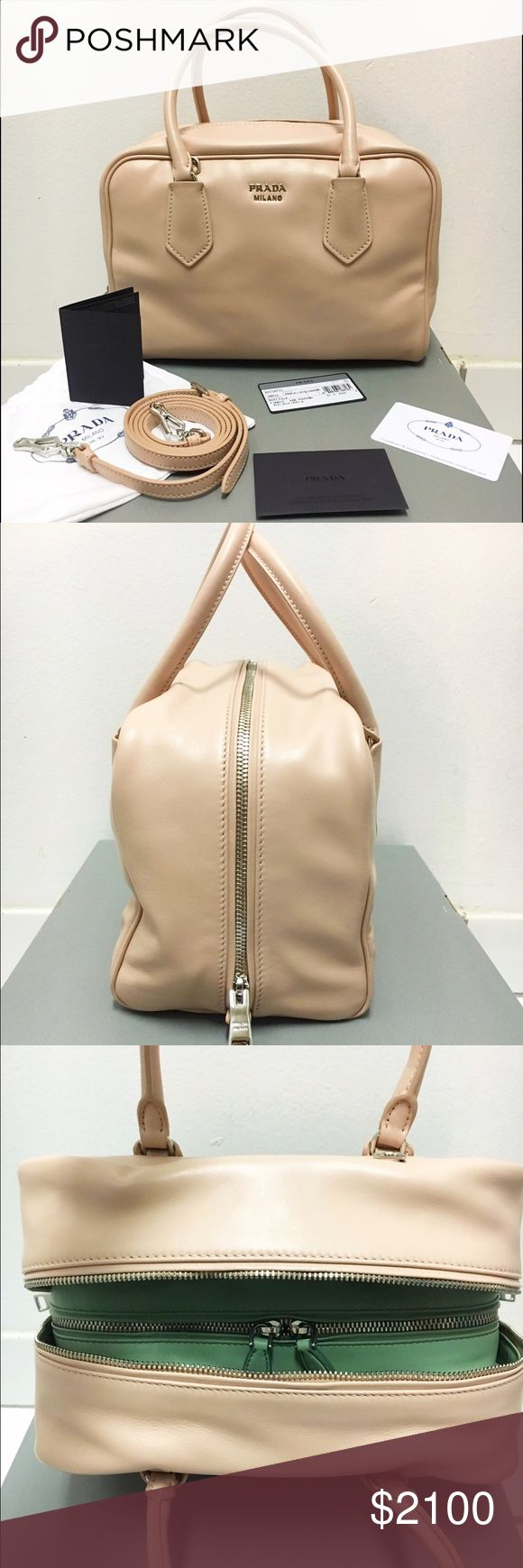 """PRADA Supple Calf Leather Satchel This unique Prada satchel is from the higher end of the design house's brand. It's has smooth supple leather and double pocketed interior in the colors Pesci and Aquamarine (Light Pink & Pistachio).   BRAND NEW. Purchased on MyHabit by Amazon on 5/9/16.  Unique satchel silhouette features 2 interior compartments with a zip and 3 slip pockets, 4.5"""" handle drop with optional adjustable shoulder strap with drop of 22"""".  Comes w/dusters, shoulder strap…"""