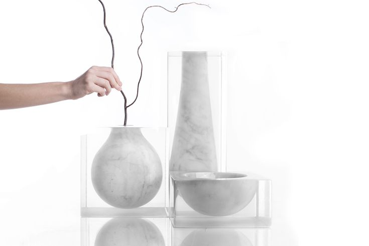 moreno ratti casts carrara marble vessels within resin blocks