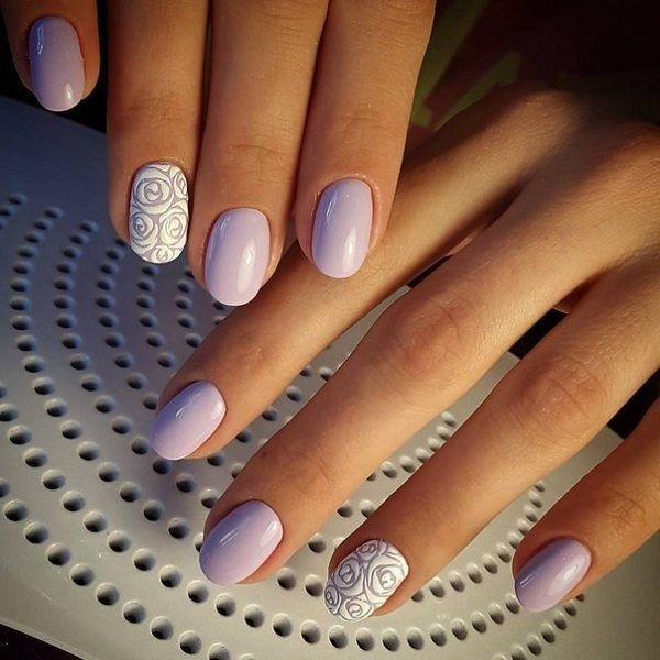 Periwinkle themed rose nail art design. The nails are painted with periwinkle polish as background while the rose is detailed with white polish. It creates a really soft effect on the nails.