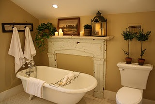 Love the mantel next to the old fashioned tub.  It's perfect!