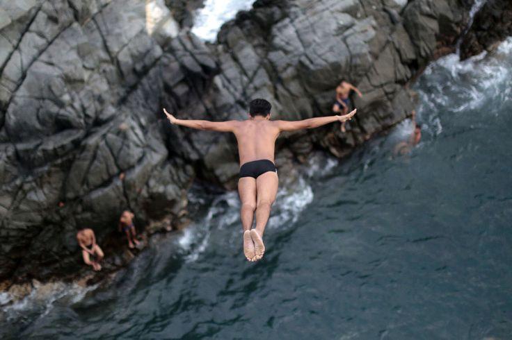 La Quebrada cliff divers jump in Acapulco, Mexico,